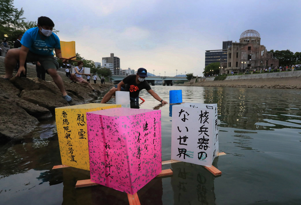 People float paper lanterns on water in Hiroshima