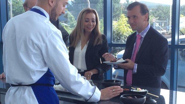 Alun Cairns samples the Oriental fare at Deeside-based KK Foods