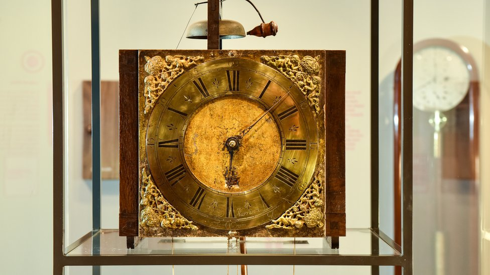 Early wooden longcase clock created in 1717