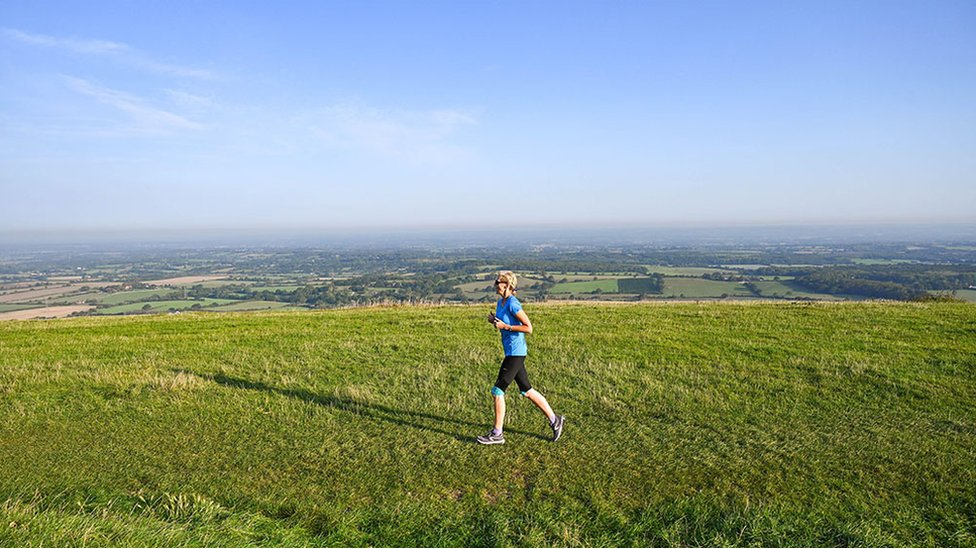 A runner enjoys the sunshine on Devils Dyke just north of Brighton