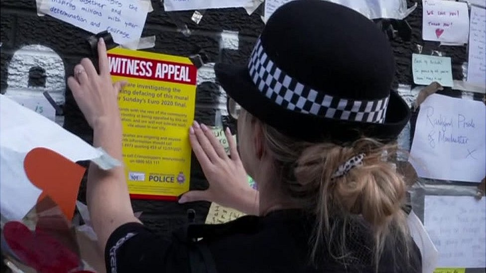 Police officer sticks witness appeal to mural
