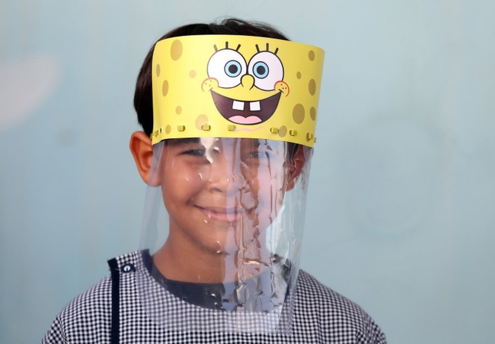 A Tunisian child wears a face shield in a school in Tunis. It features cartoon character Spongebob Squarepants.