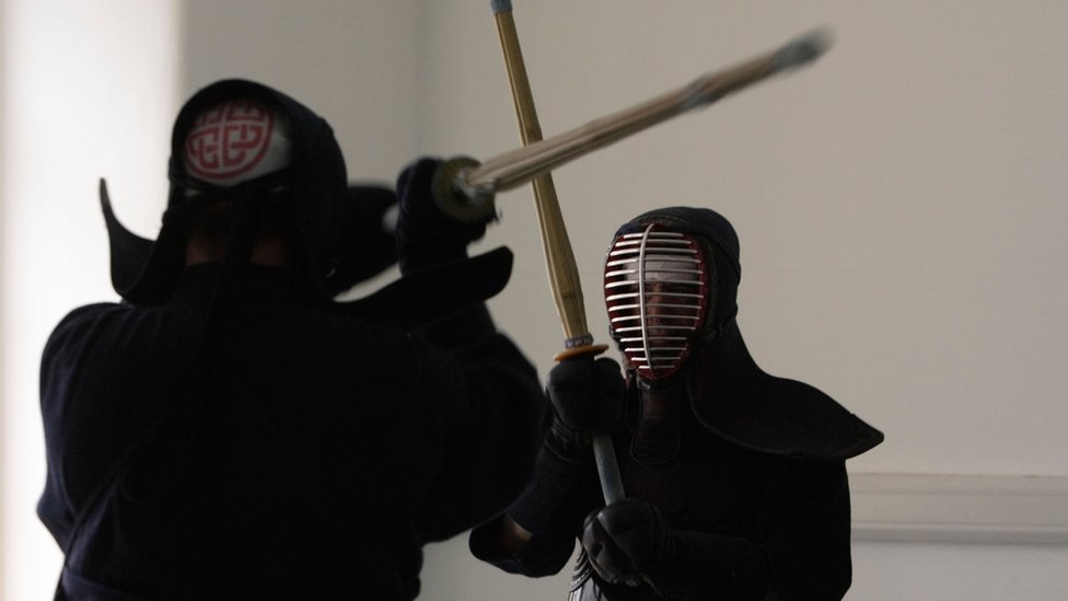 File photo of two people practising kendo
