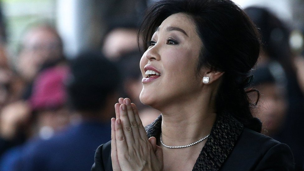 Yingluck Shinawatra greets supporters as she arrives at the Supreme Court in Bangkok, Thailand, August 1, 2017