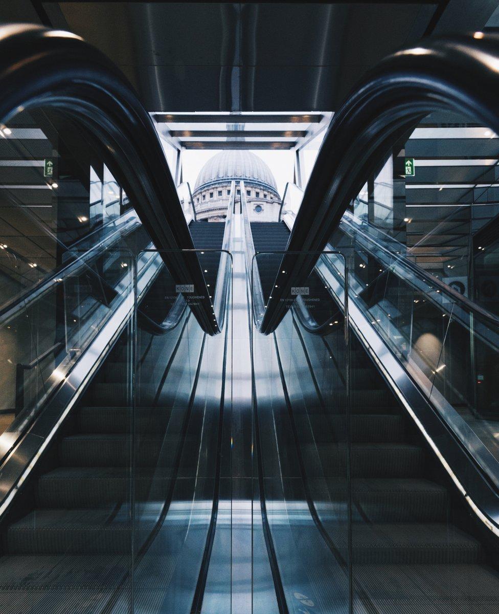 Mirrored view up escalators