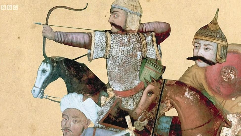Imagen de soldados a caballo disparando flechas