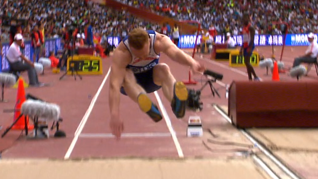 Greg Rutherford competes in the long jump heats