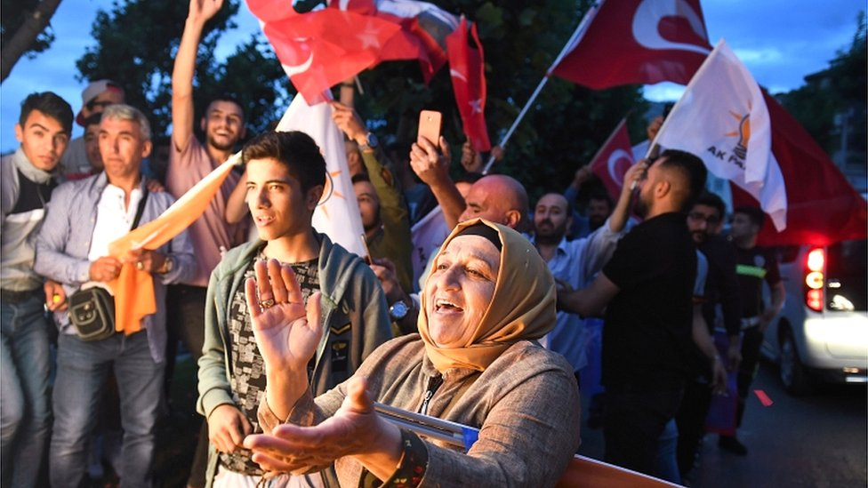 Erdogan supporters celebrate outside the AK party headquarters on 24 June 2018 in Istanbul, Turkey