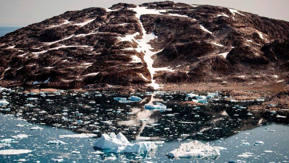 A glacier releasing water