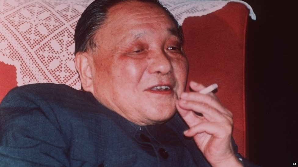 Chinese leader Deng Xiaoping smokes a cigarette