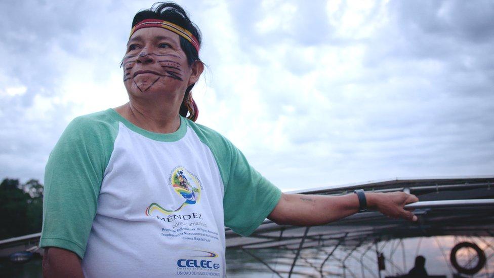 Navigator and community elder, Hilario Saant stands on the solar canoe