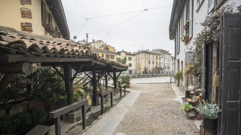 The bars and cafes in Milan's Navigli district may not be bustling for now, but by 2025 smoking will be banned here too