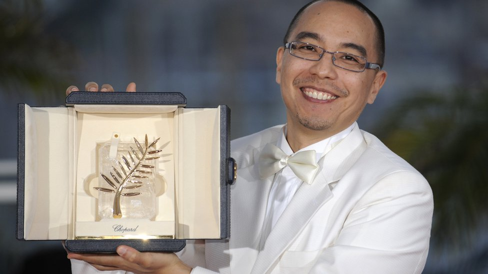 """Thai director Apichatpong Weerasethakul poses after receiving the Palme d'Or award for his film """"Lung Boonmee Raluek Chat"""" (Uncle Boonmee Who Can Recall His Past Lives) during the closing ceremony at the 63rd Cannes Film Festival in 2010."""