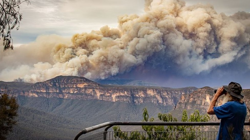 Huge plumes of smoke from a bushfire are seen at a lookout in the Blue Mountains west of Sydney