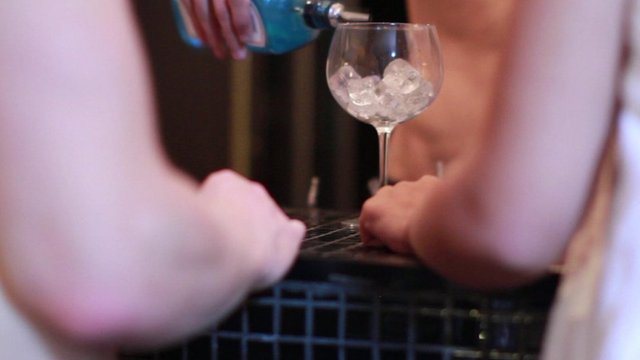 Naked people, being served gin