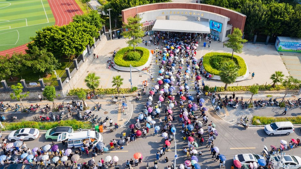 Aerial view of local residents queue up for COVID-19 nucleic acid testing at a primary school on September 14, 2021 in Xiamen, Fujian Province of China