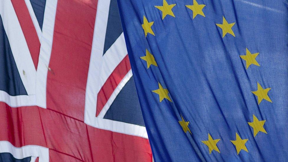 Union Jack flag flying next to the European Union flag