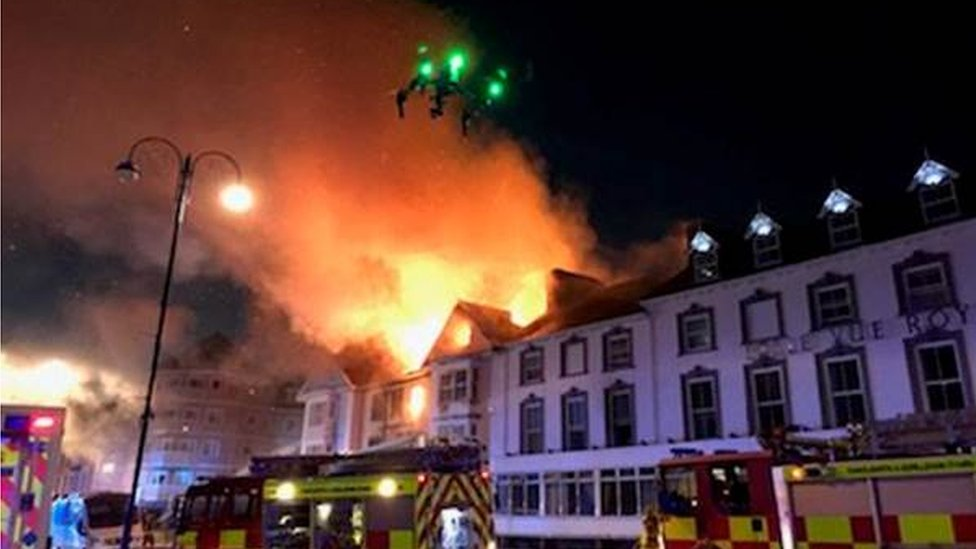 Drone flying over the burning hotel