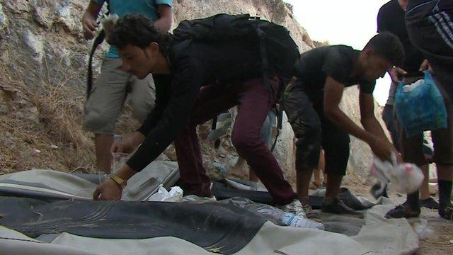 Refugees picking up litter