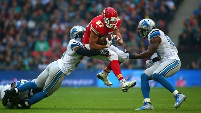 Kansas City Chiefs tight end Travis Kelce is tackled
