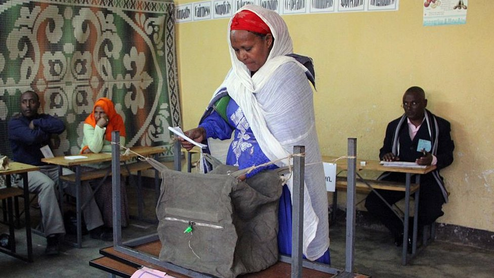 A woman casts her vote for Ethiopian Parliamentary Election in Addis Ababa, Ethiopia, on May 24, 2015