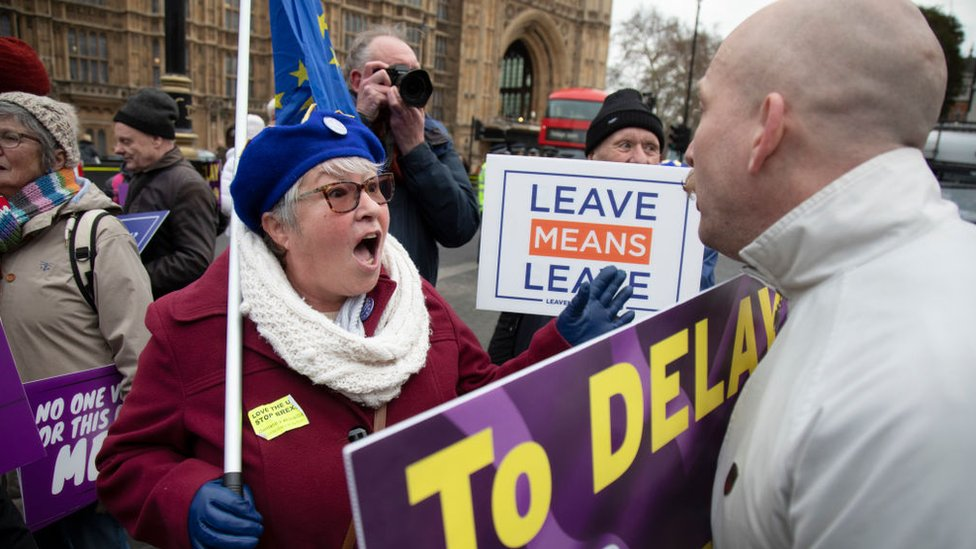 Pro- and anti-Brexit demonstrators argue outside Parliament in London