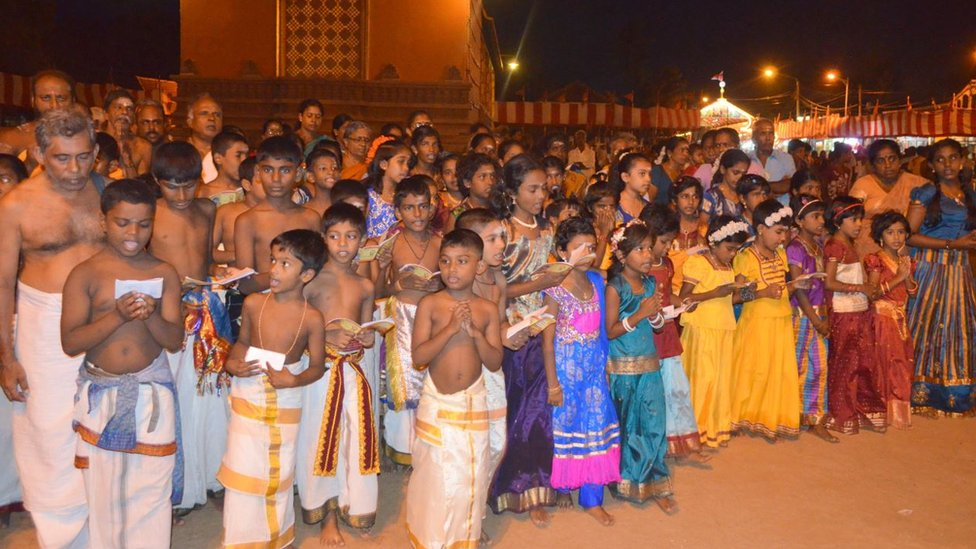 Tamil Hindu children sing religious prayers during the Nallur Festival at Jaffna,