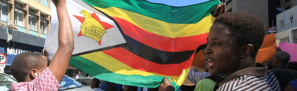 Christians march while brandishing the Zimbabwean national flag in Harare, Zimbabwe - May 2016