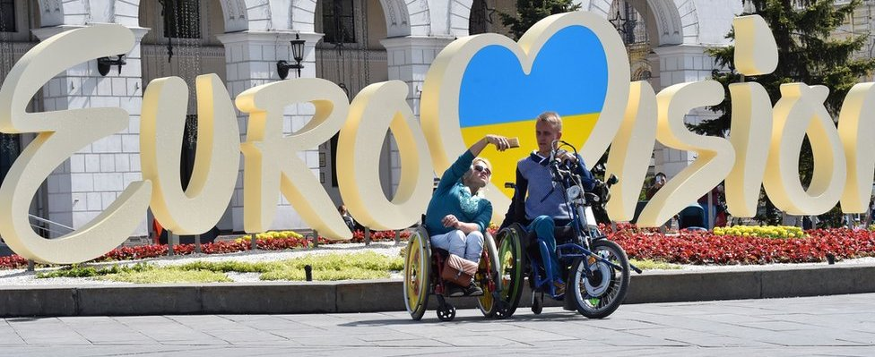 Tourists pose for selfies in Kiev