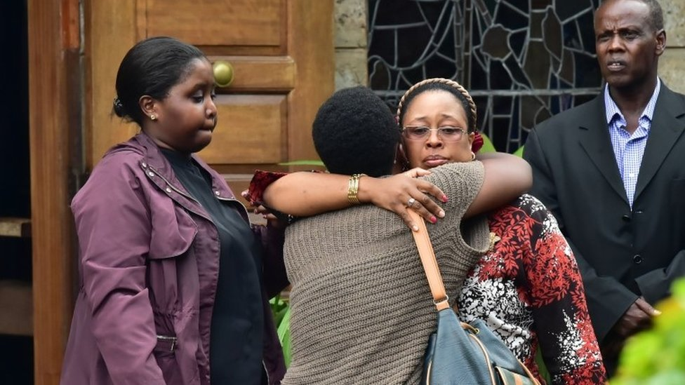"""Relatives and friends consoles a family member outside the Lee Funeral Home, following the death of former Kenya""""s president Daniel Arap Moi, in Nairobi on February 4, 2020."""