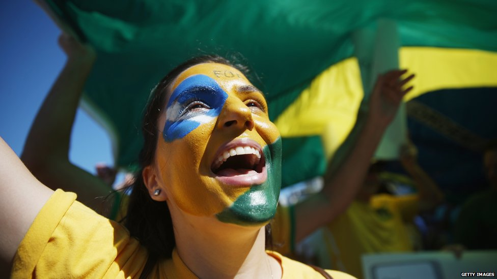 A protester calling for the impeachment of President Dilma Rousseff cheers along Copacabana beach on 16 August 2015
