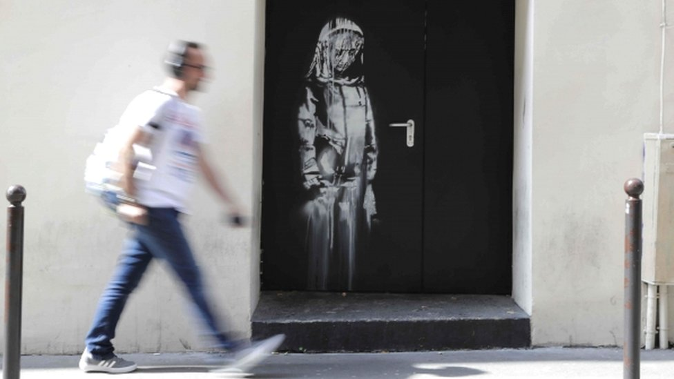 An artwork by street artist Banksy in Paris, on a side street to the Bataclan concert hall, 25 June 2018