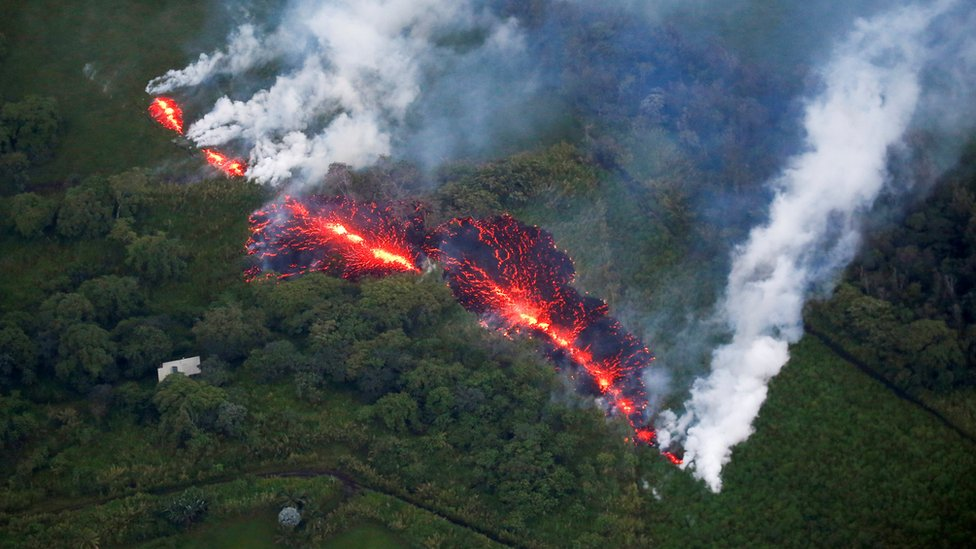 Lava erupts from a fissure east of the Leilani Estates subdivision during ongoing eruptions of the Kilauea Volcano in Hawaii on 13 May 2018.