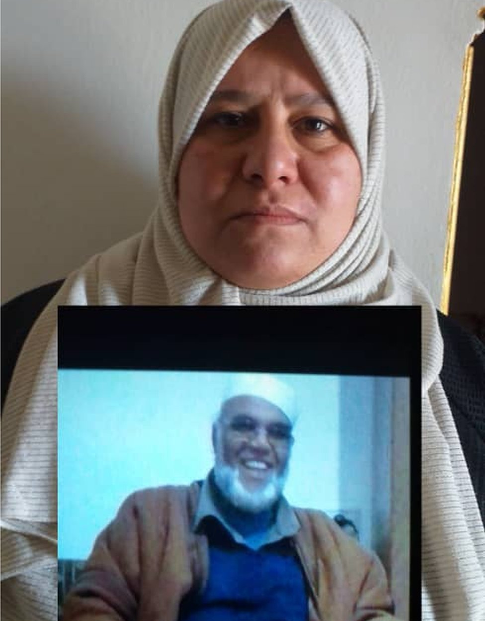 Hanan Abu-Kleish with photograph of one of her missing uncles