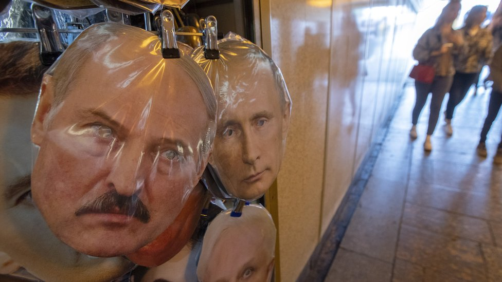 Masks of Belarus President Alexander Lukashenko (L) and Russian President Vladimir Putin displays on the street souvenir market in St. Petersburg, Russia, 15 August 2020.