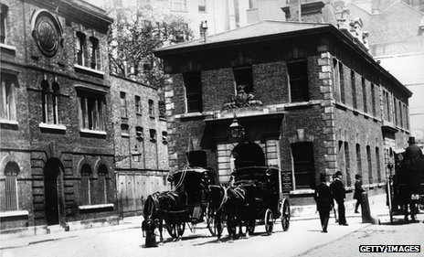 Scotland Yard, left, next to Public Carriage Office in 1875
