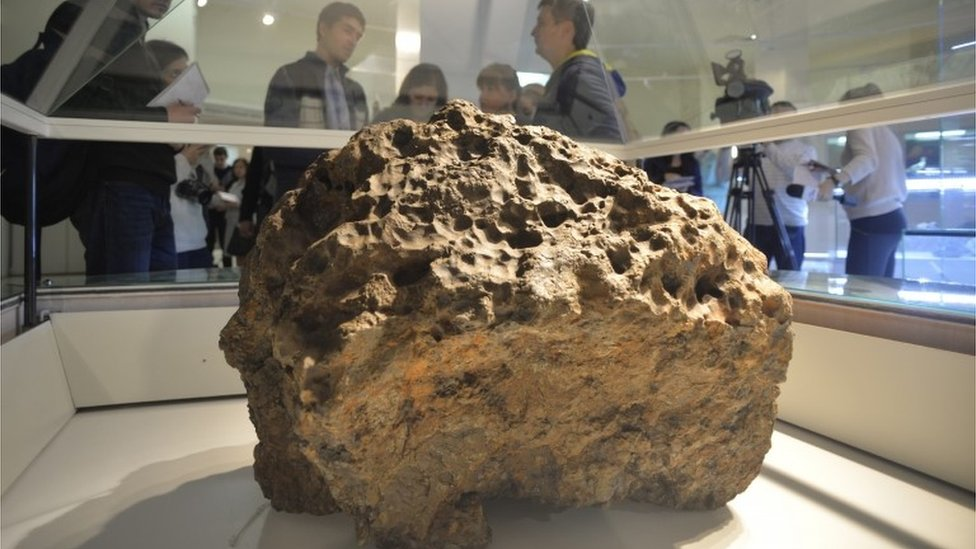 Part of the Chelyabinsk meteorite in Russia, recovered from Lake Chebarkul, in a museum on 18/10/2013