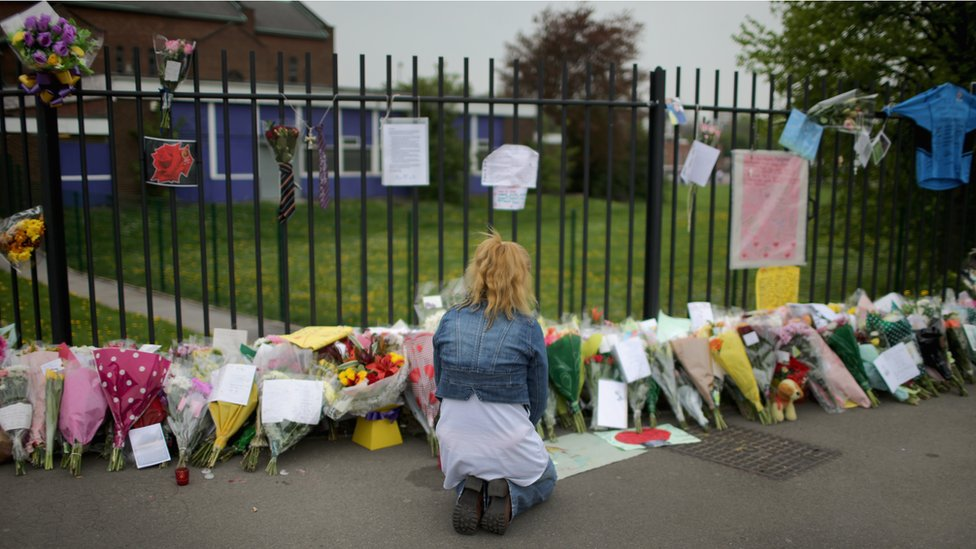 Floral tributes placed outside Corpus Christi Catholic College after teacher Ann Maguire was stabbed to death