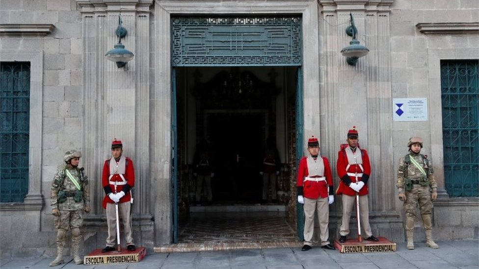 Military members stand guard at an entrance of the Presidential Palace in La Paz, Bolivia November 13, 2019.