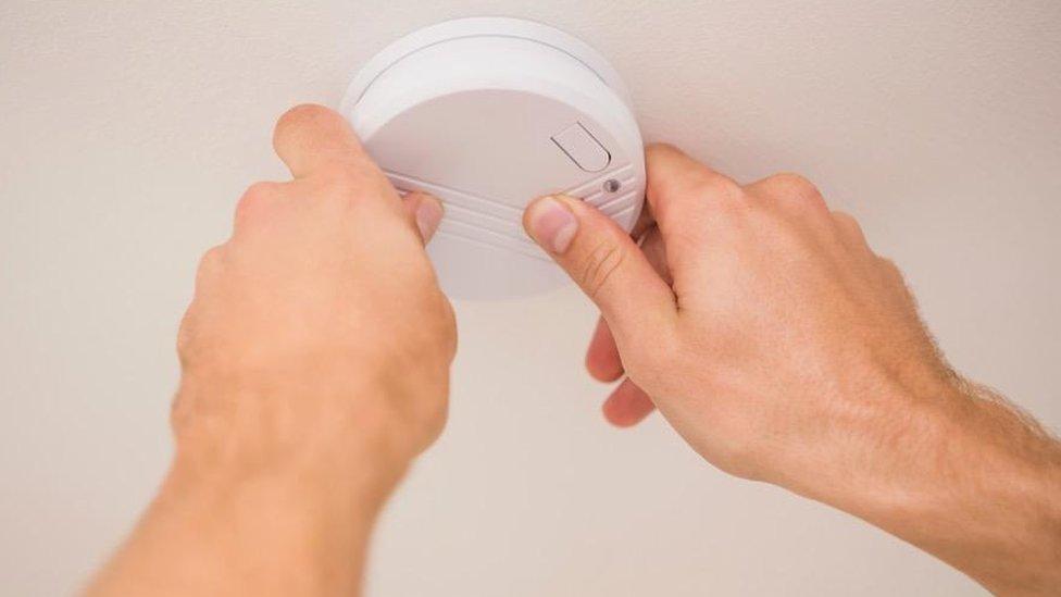 Person installing a sensor