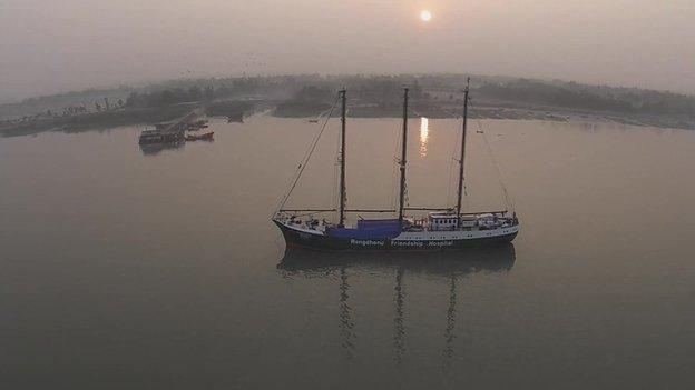An aerial shot of a ship at anchor