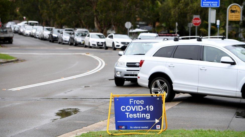 Cars queue for drive-thru Covid-19 testing in Sydney, Australia