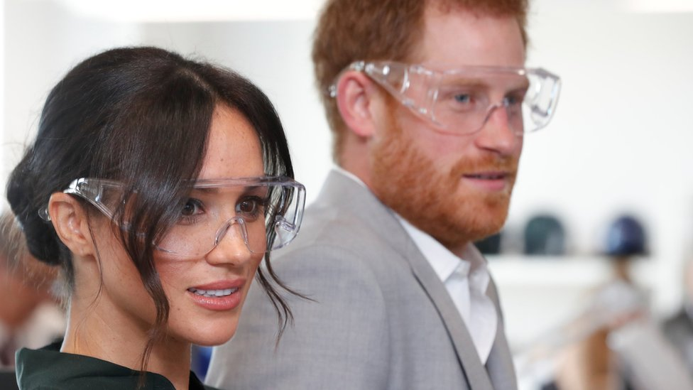 The Duke and Duchess of Sussex don goggles in an engineering lab