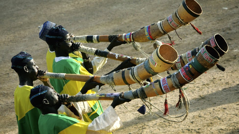 Men blow a traditional horn part of a Durbar in Nigeria - 2006