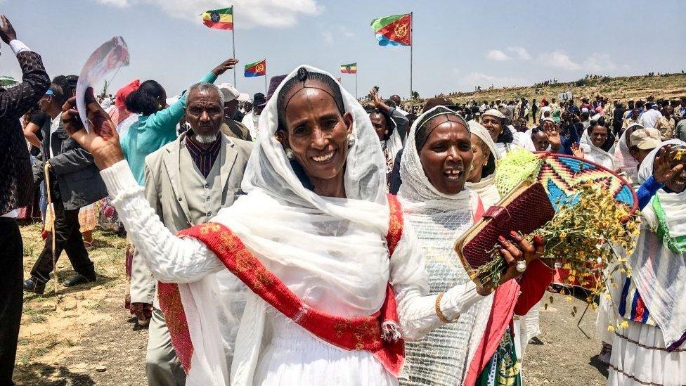 Women waving and smiling