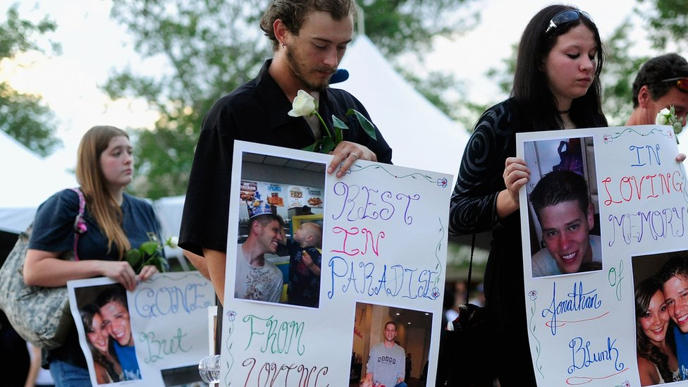 AURORA, CO - JULY 22: Family members of the 12 victims of the mass shooting at Century 16 movie theater attend a prayer vigil at the Aurora Municipal Center July 22, 2012 in Aurora, Colorado