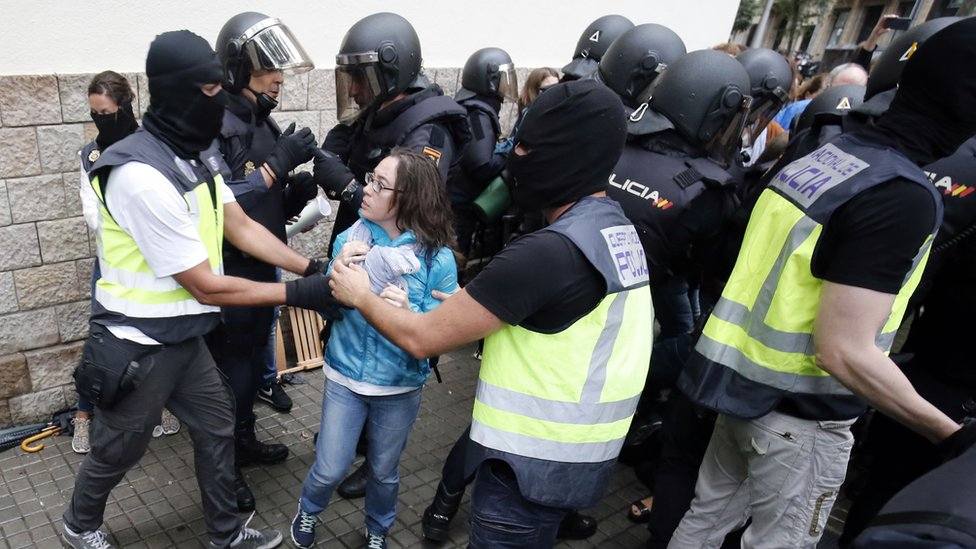 Police disrupting the Catalonian independence referendum in 2017