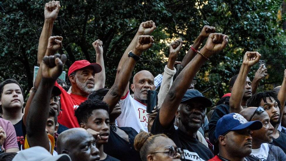 People participate in a protest against the NFL and in support of Colin Kaepernick in New York