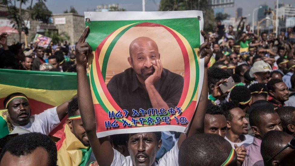Crowds with picture of Berhanu Nega