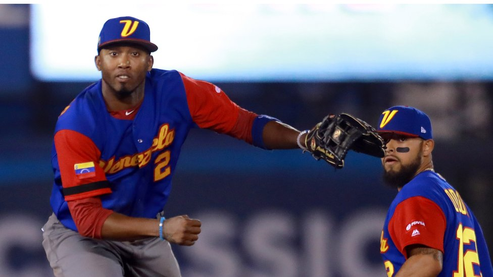 Alcides Escobar #2 of Venezuela throws to first after tagging out Rob Segedin #21 of Italy in the bottom of the eighth inning during the World Baseball Classic Pool D Game 7 between Venezuela and Italy at Panamericano Stadium on March 12, 2017 in Zapopan, Mexico.